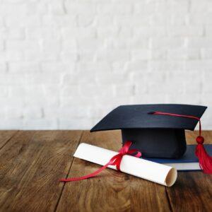 Mortar board and a graduation diploma